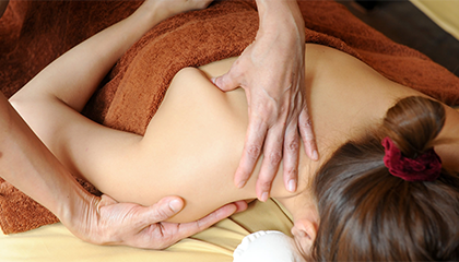 Photo of a woman receiving a massage